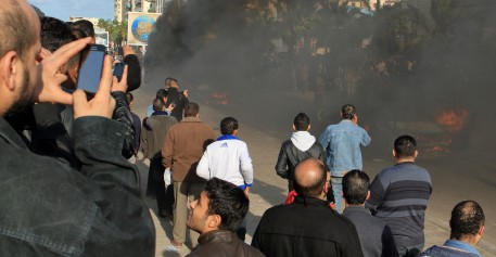 Alexandria, Egypt  - December 14, 2012: People at Demonstrations and burning cars in Alexandria Egypt